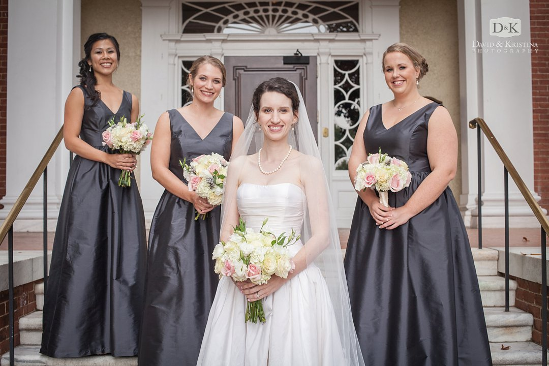 bride and bridesmaids in front of Poinsett Club