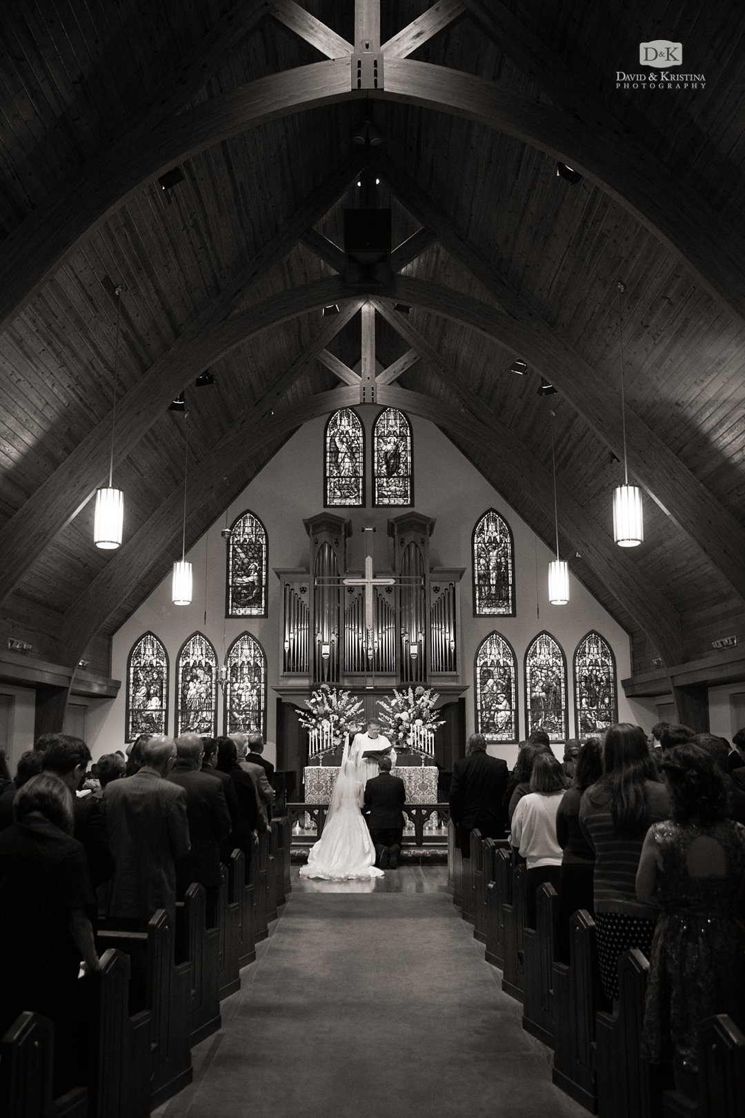 bride and groom kneeling during St. James Episcopal wedding