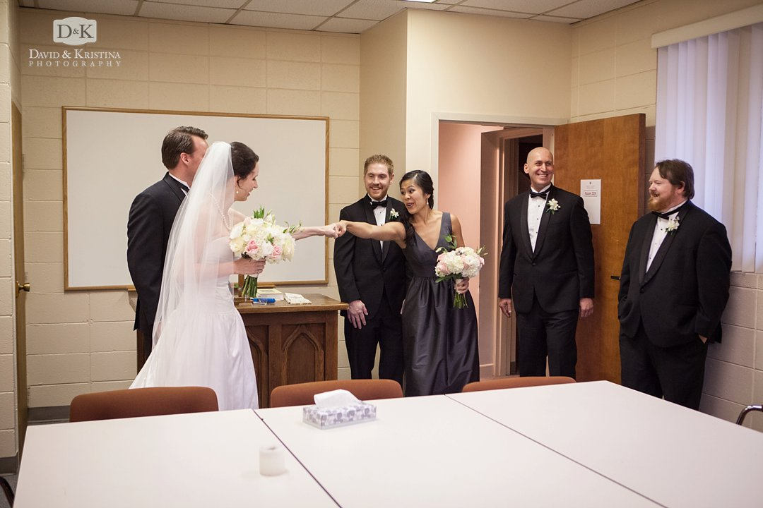 bride gives fist bump after wedding
