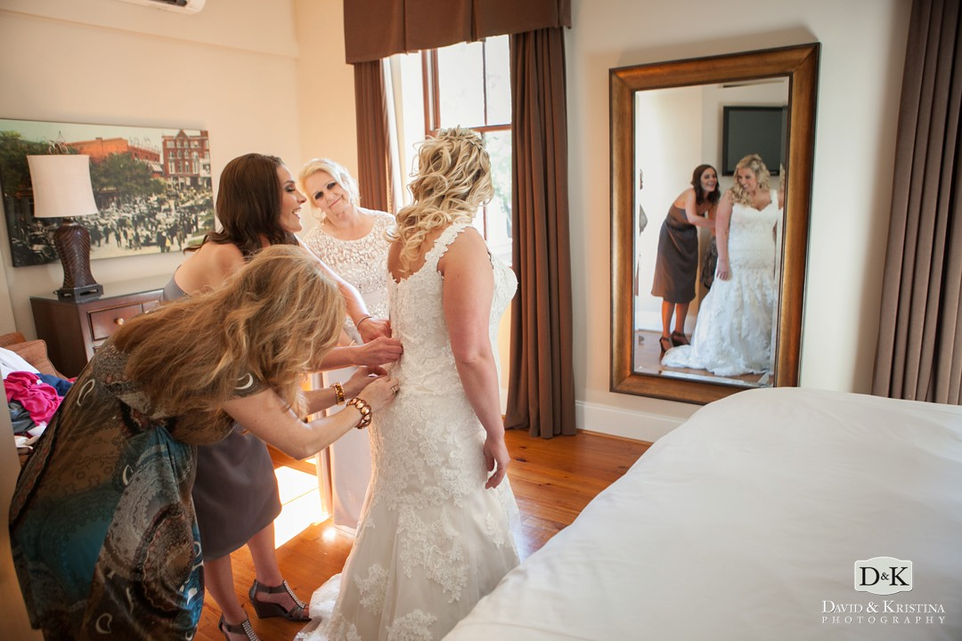 bride getting into dress in guest suite at The Bleckley Inn