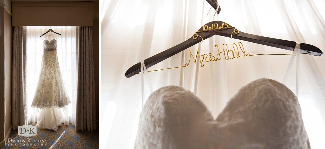 wedding dress hanging from window