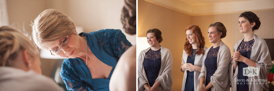 mother of bride fastens back of dress