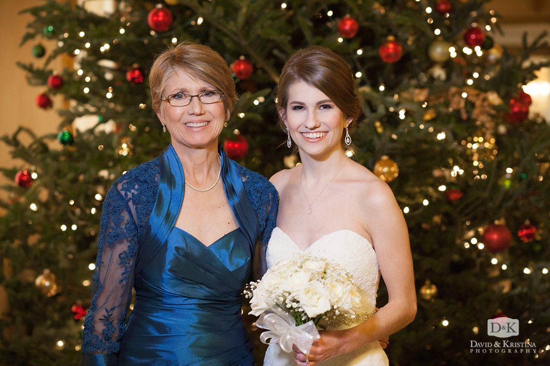 bride and mother in front of Christmas tree