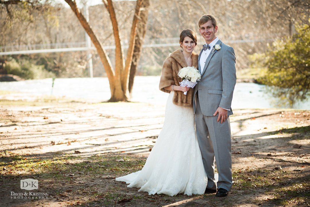 bride and groom in Falls Park on the Reedy River