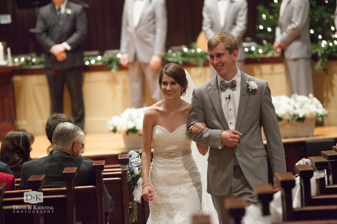 bride and groom recess up the aisle