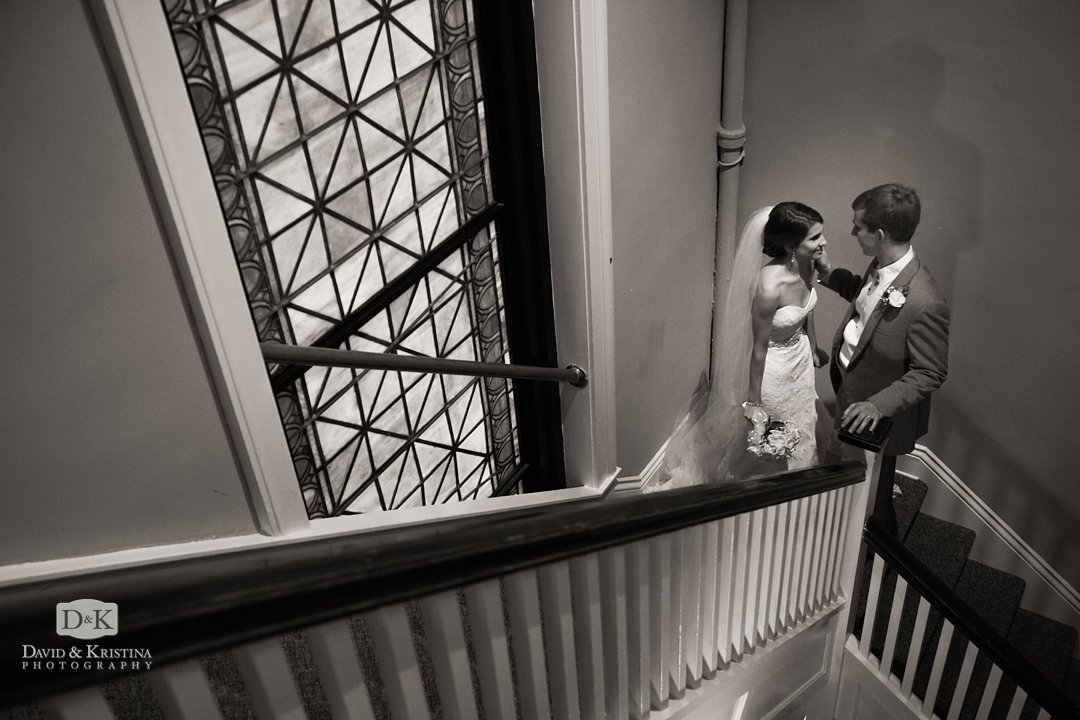bride and groom on stairs after wedding