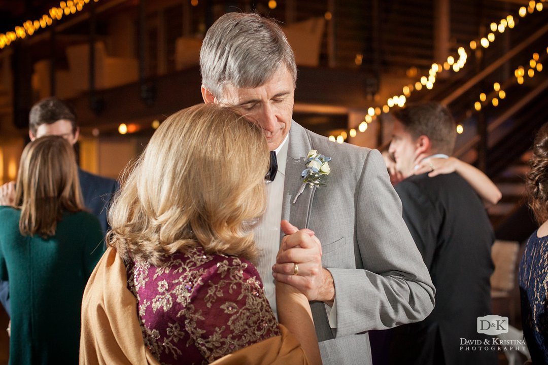 parents of groom dancing at reception