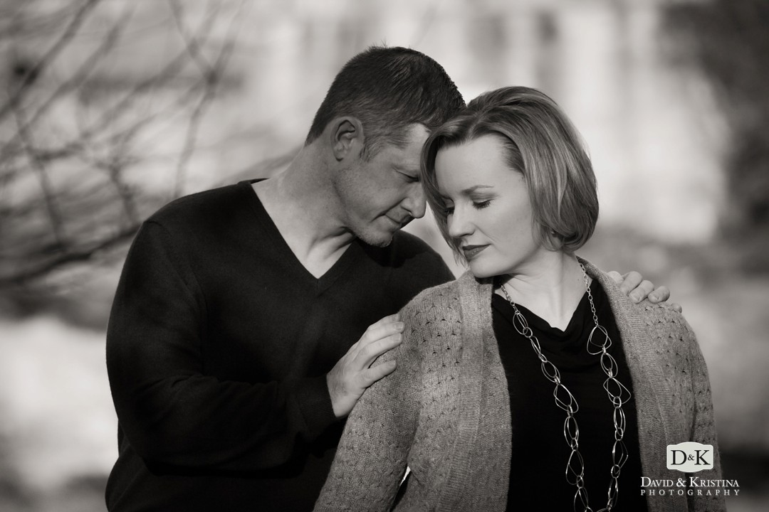 black and white romantic engagement photo under Liberty Bridge
