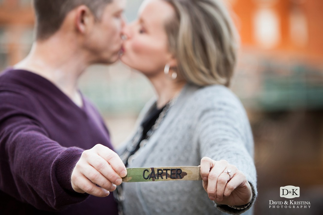 engagement photo holding military name patch from uniform