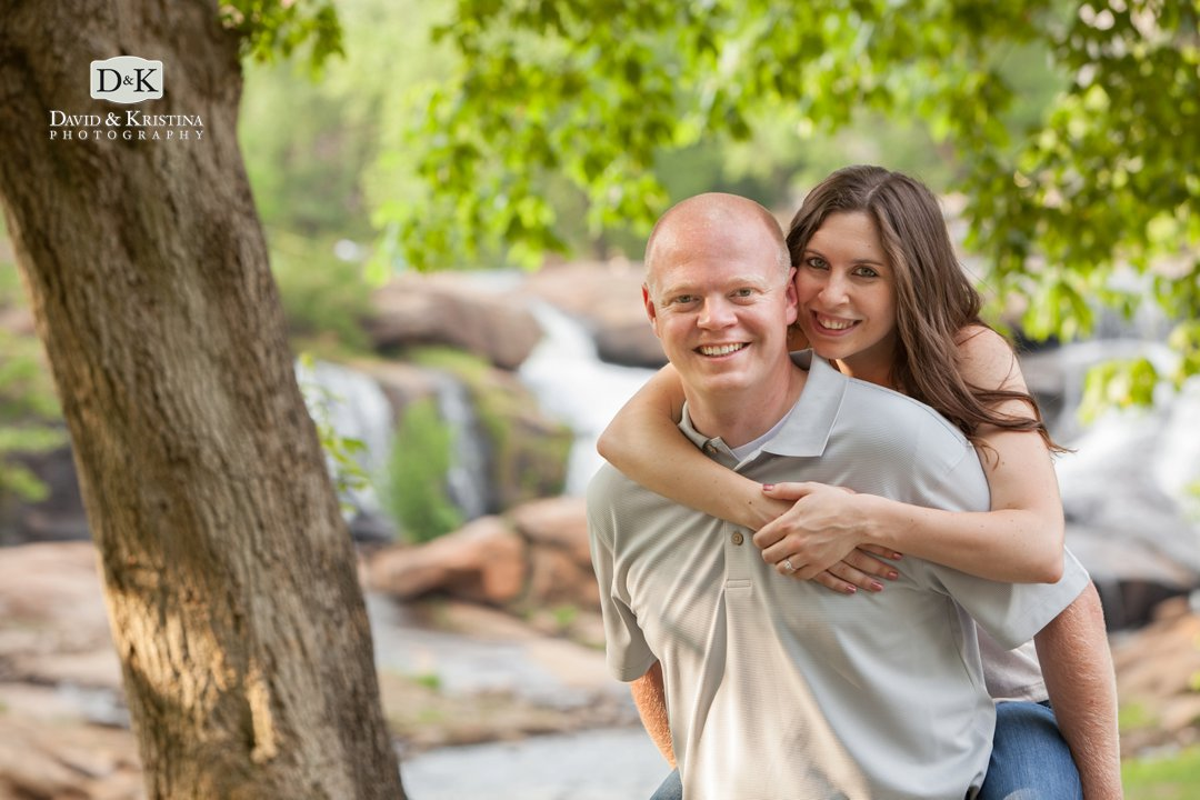 engaged couple in front of Reedy River Falls