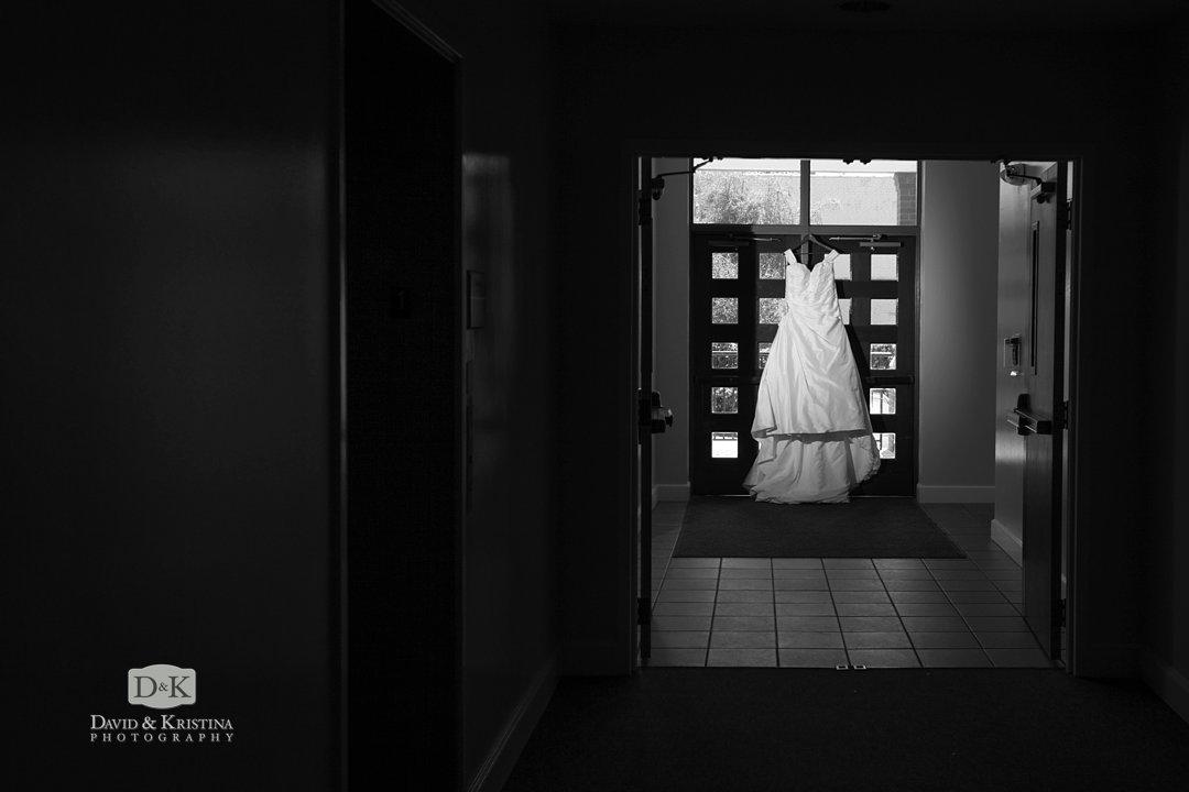 bride's dress hanging in doorway in Sacred Heart Hall