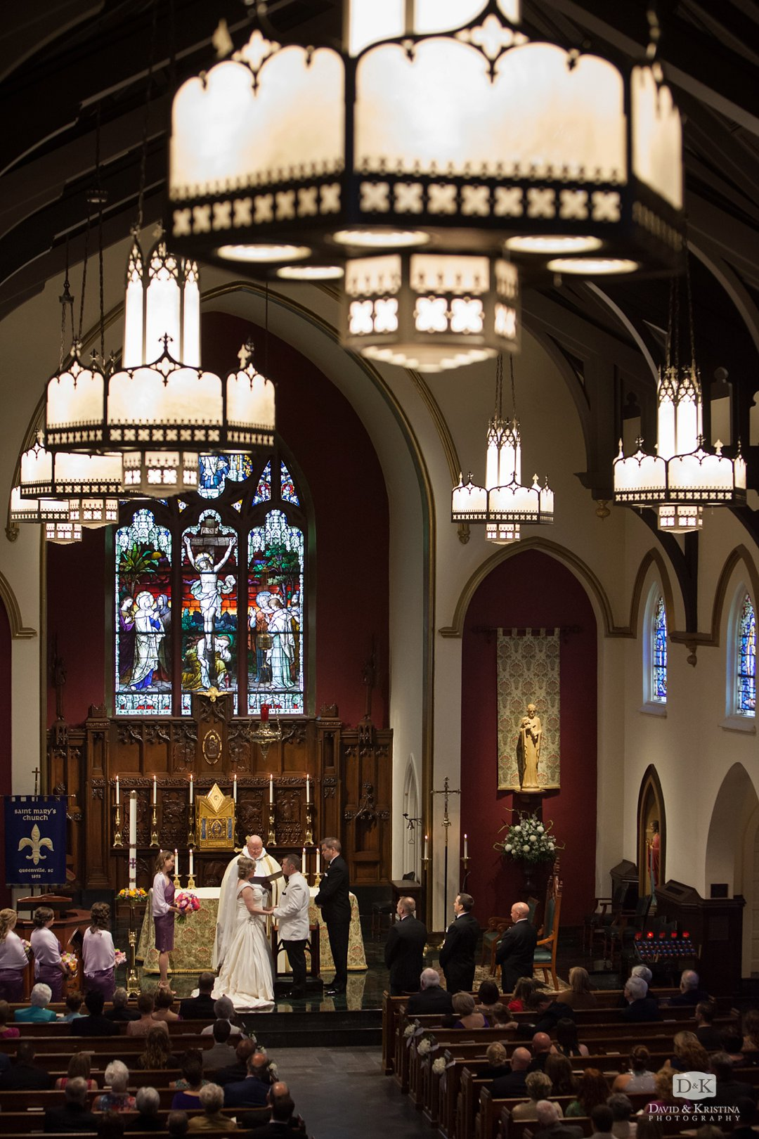 Exchanging vows at St. Mary's Catholic wedding