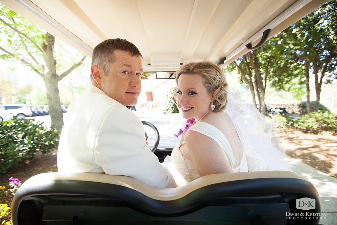 Mike and Megan driving golf cart