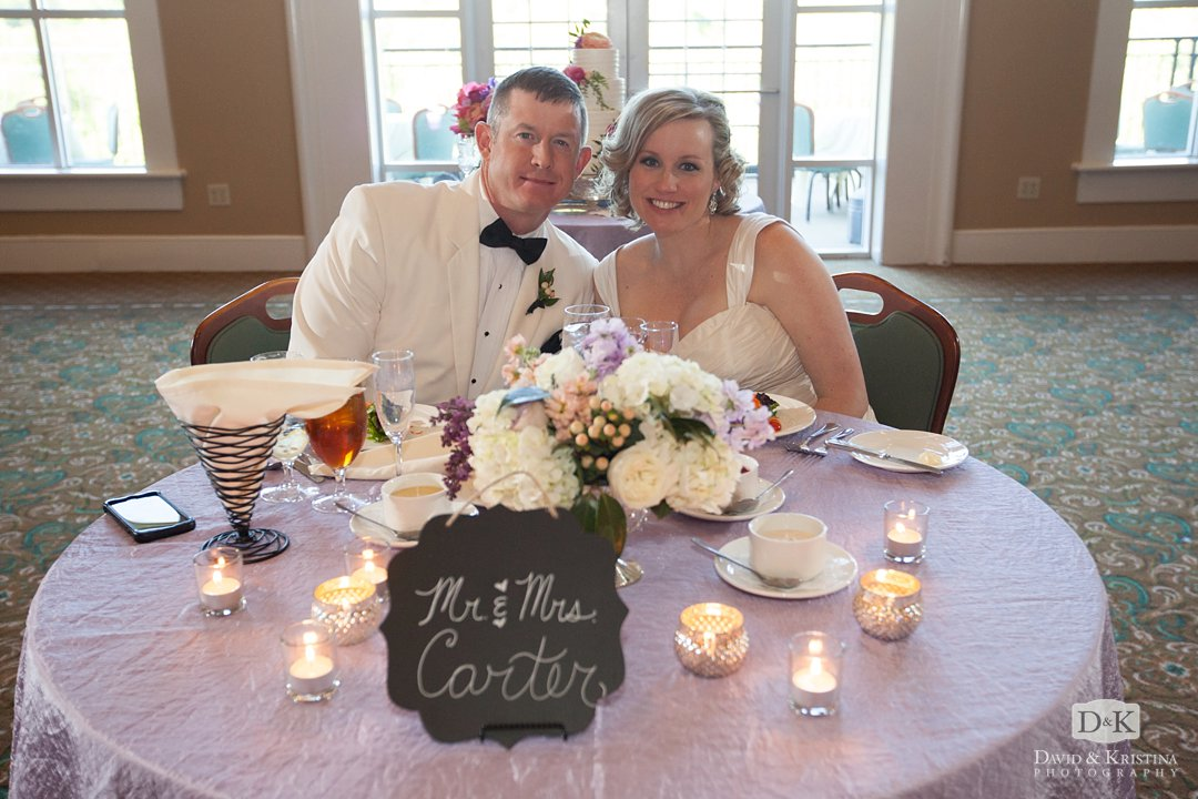 Sweetheart table in ballroom at Thornblade Country Club wedding reception