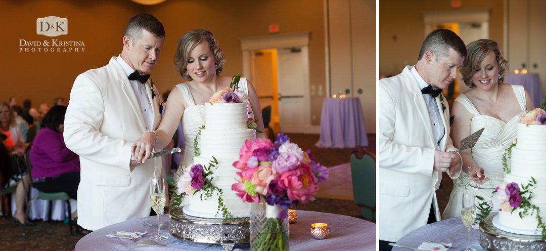 Mike and Megan cut wedding cake