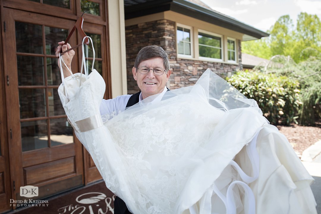 father holding daughter's wedding dress