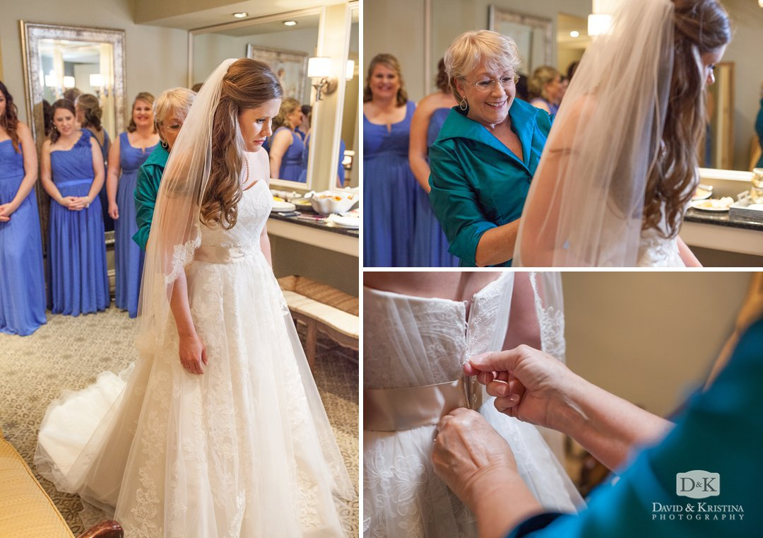 bride putting on dress in bridal suite at Glassy Mountain Clubhouse