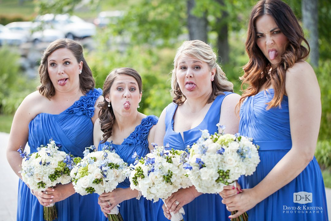 bridesmaids sticking out their tongues at the camera