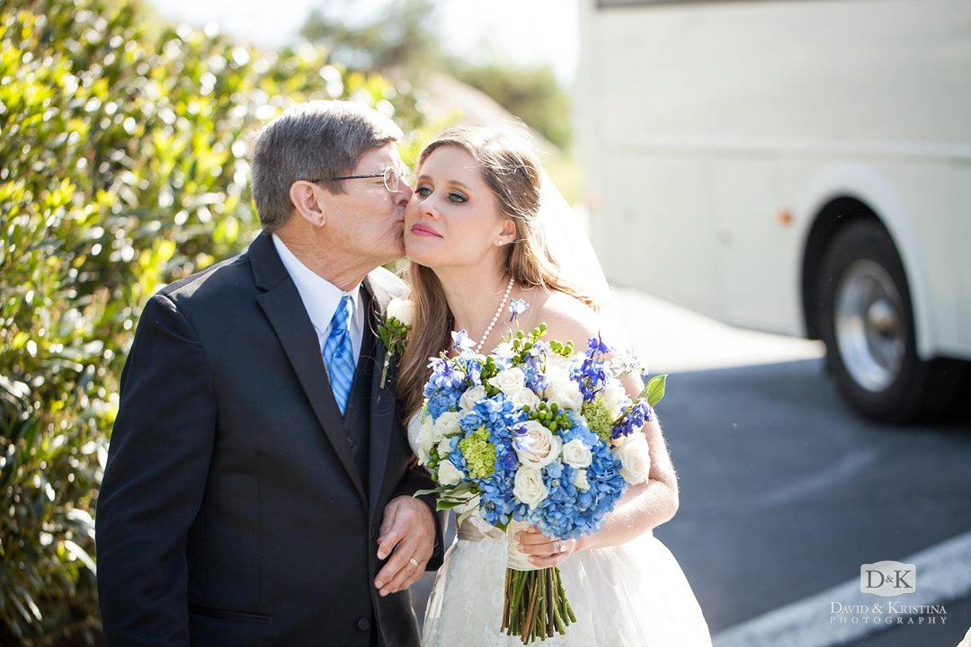 Carrie's dad kissing her on the cheek before walking her down the aisle