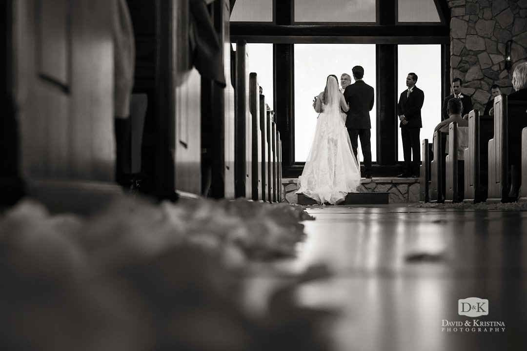 flower petals on the aisle floor of the Glassy Mountain Chapel
