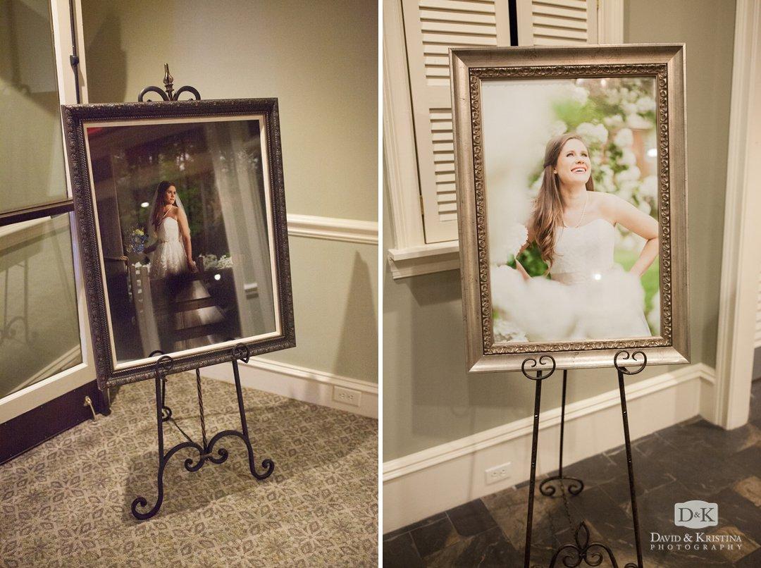 framed bridal portraits on display at wedding reception