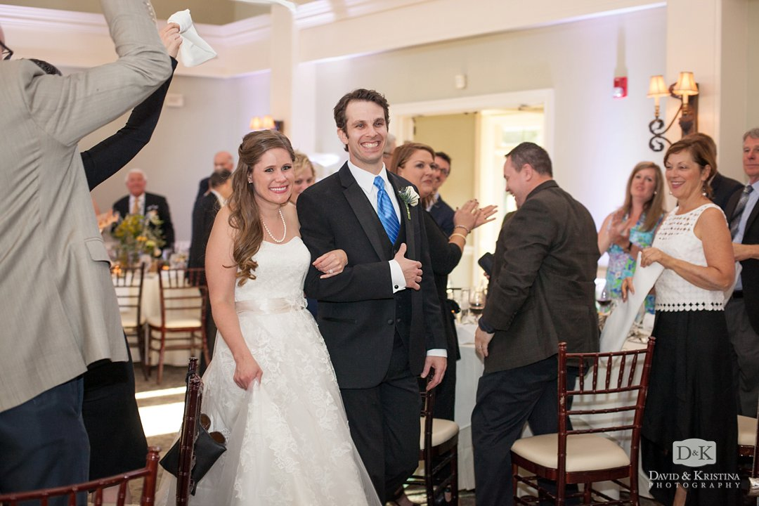 bride and groom enter reception at Glassy Mountain Clubhouse