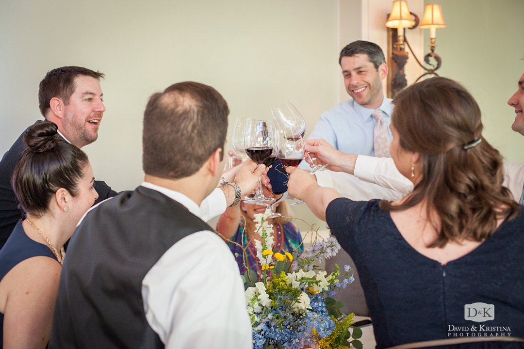wedding guests toast wine glasses