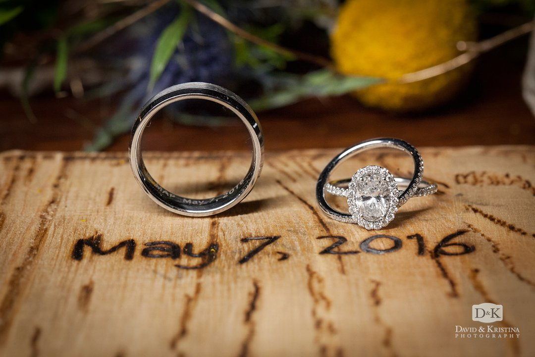 wedding rings on piece of wood with date burned in