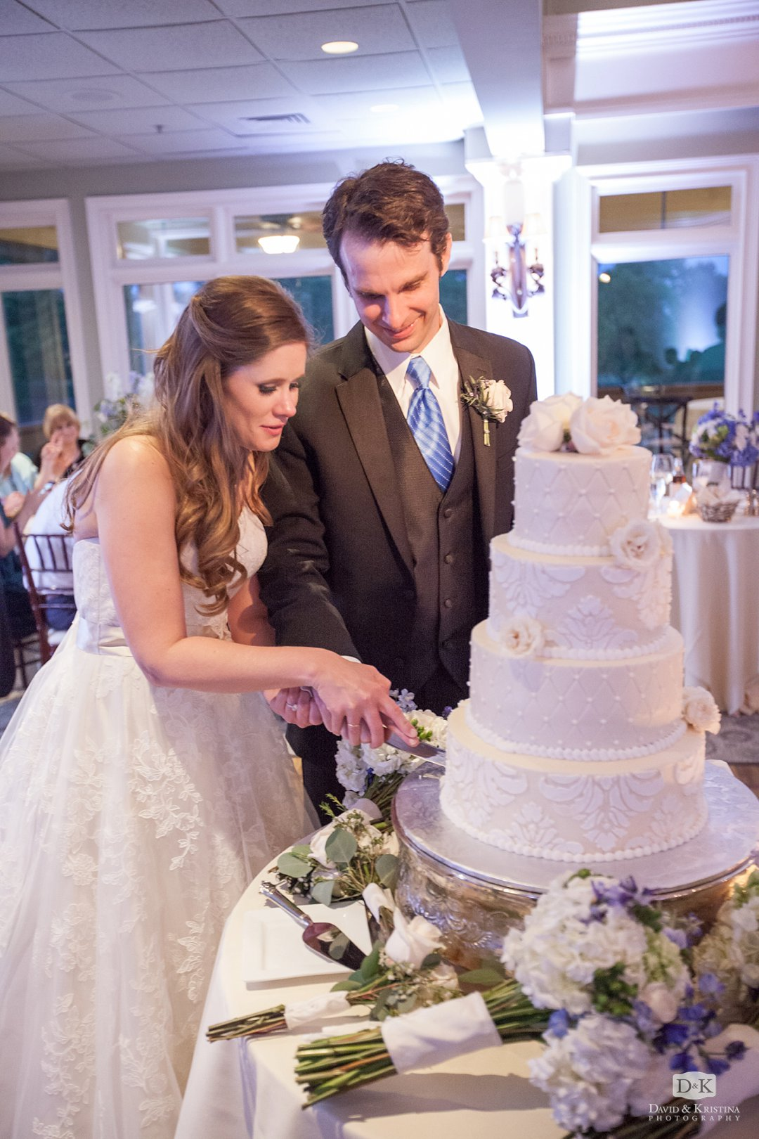 Mike and Carrie cut their wedding cake