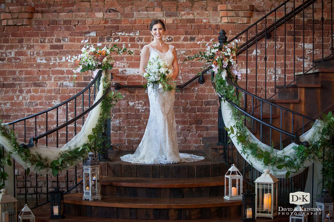 bridal portrait on grand staircase of The Old Cigar Warehouse