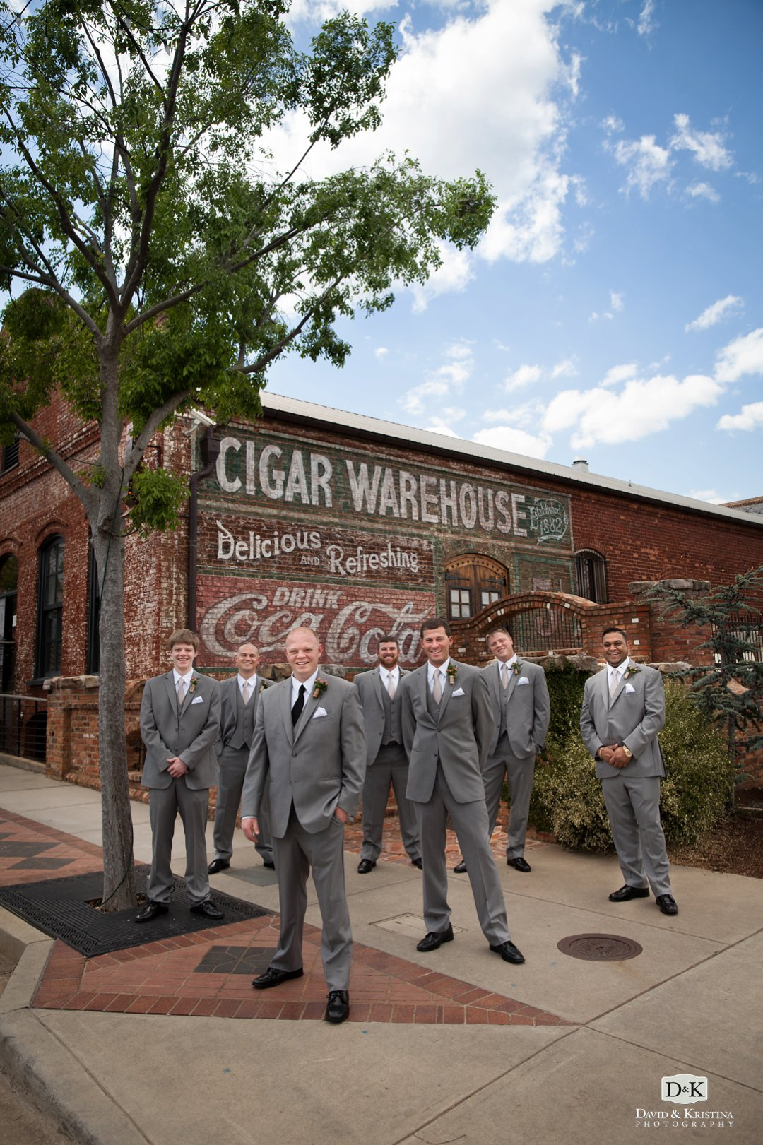 old cigar warehouse wedding photo of groomsmen