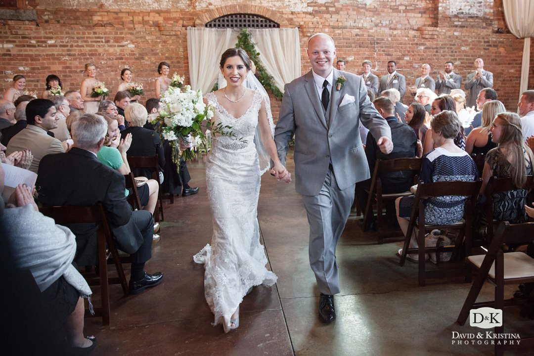 Logan and Lindsey walk down the aisle as husband and wife