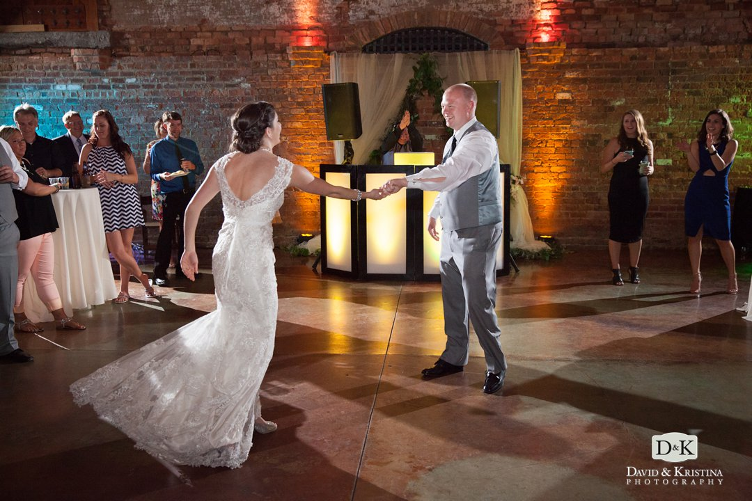 Bride and groom dance at The Old Cigar Warehouse wedding venue
