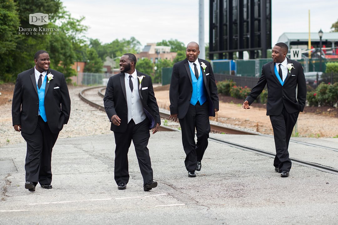 groomsmen walking across street