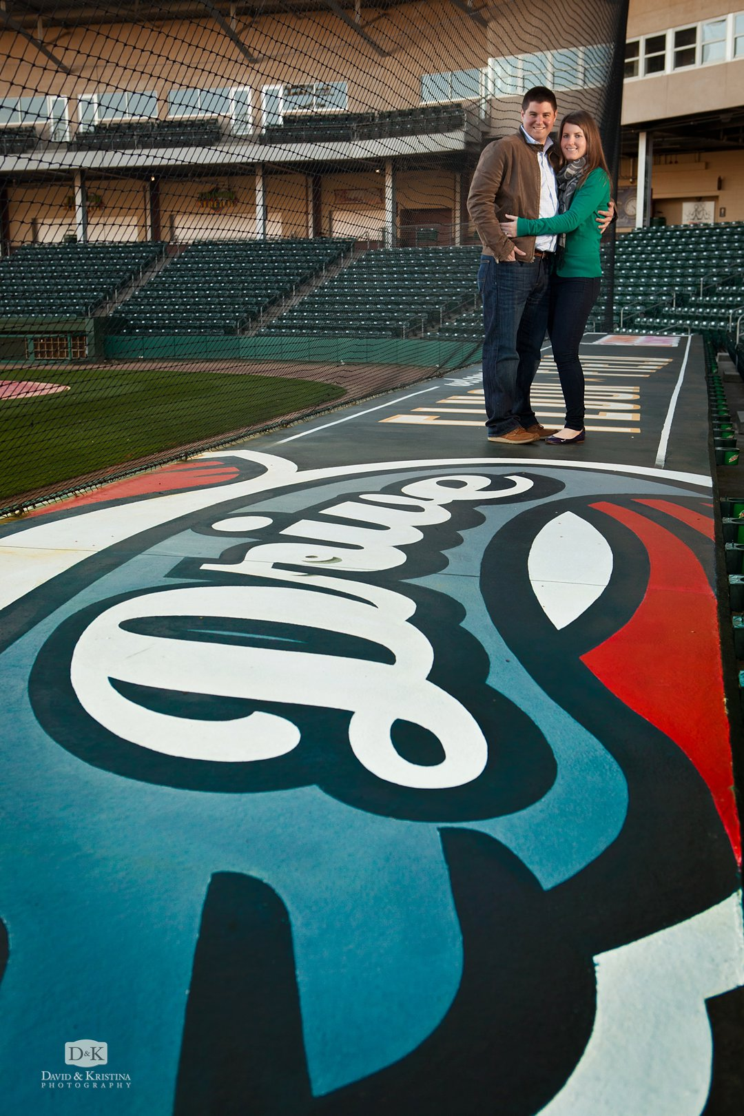 Greenville Drive baseball engagement photo at Fluor Field