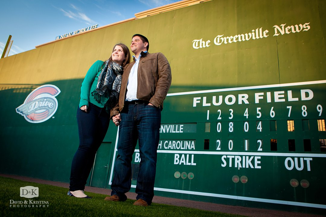 Katie and Mike in front of Green Monster of Greenville Drive Fluor Field
