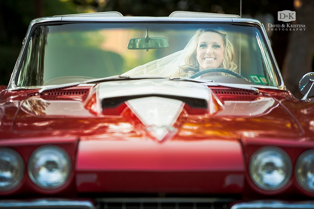looking through the windshield of red Corvette