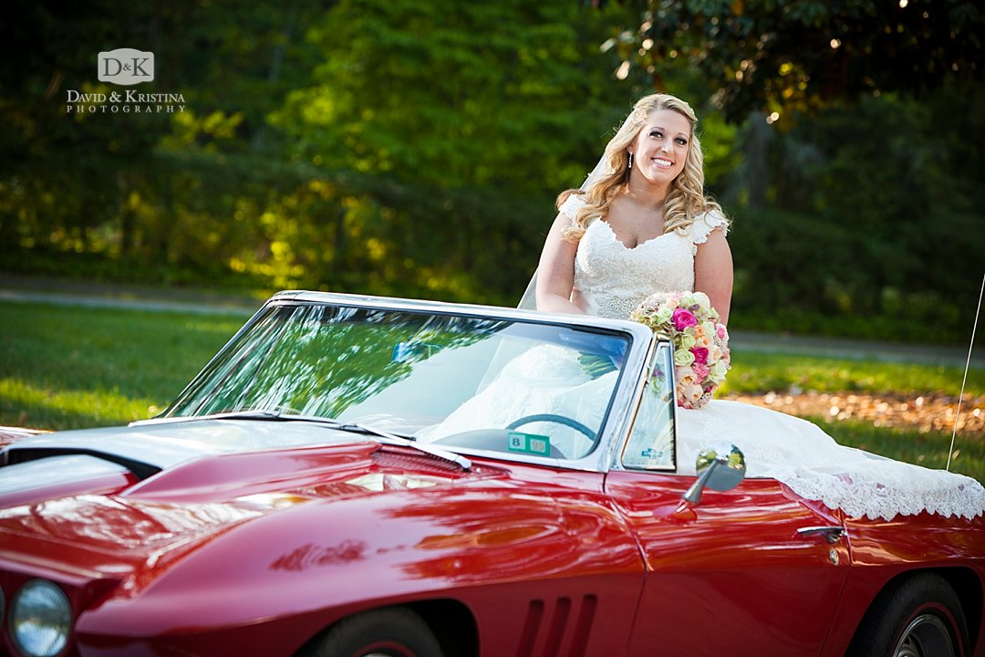 bride sitting on red Corvette