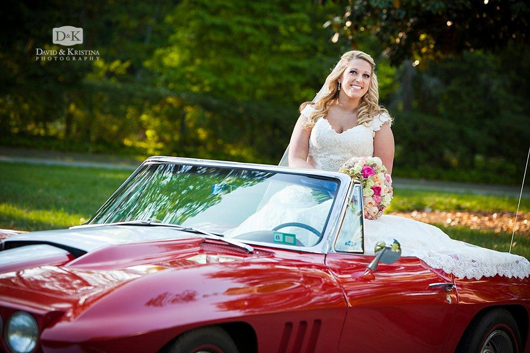 bride sitting on red Corvette