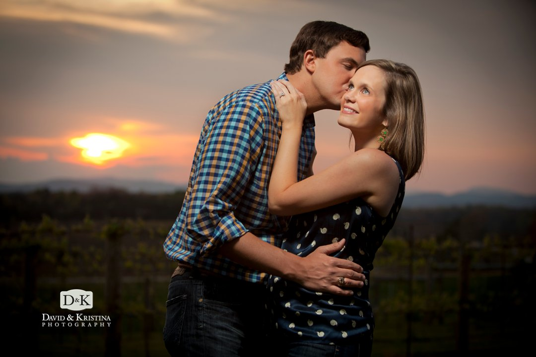 Kissing at sunset engagement photo Chattooga Belle Farm