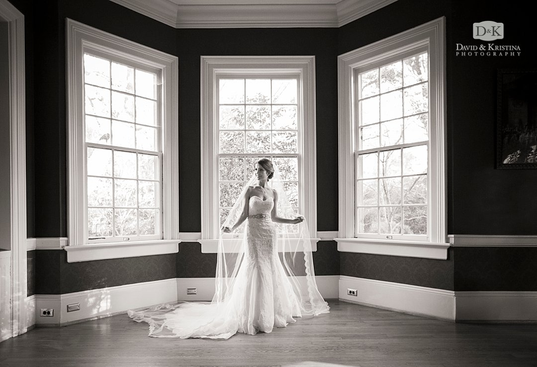 bridal portrait in front of bay windows at Duncan Estate