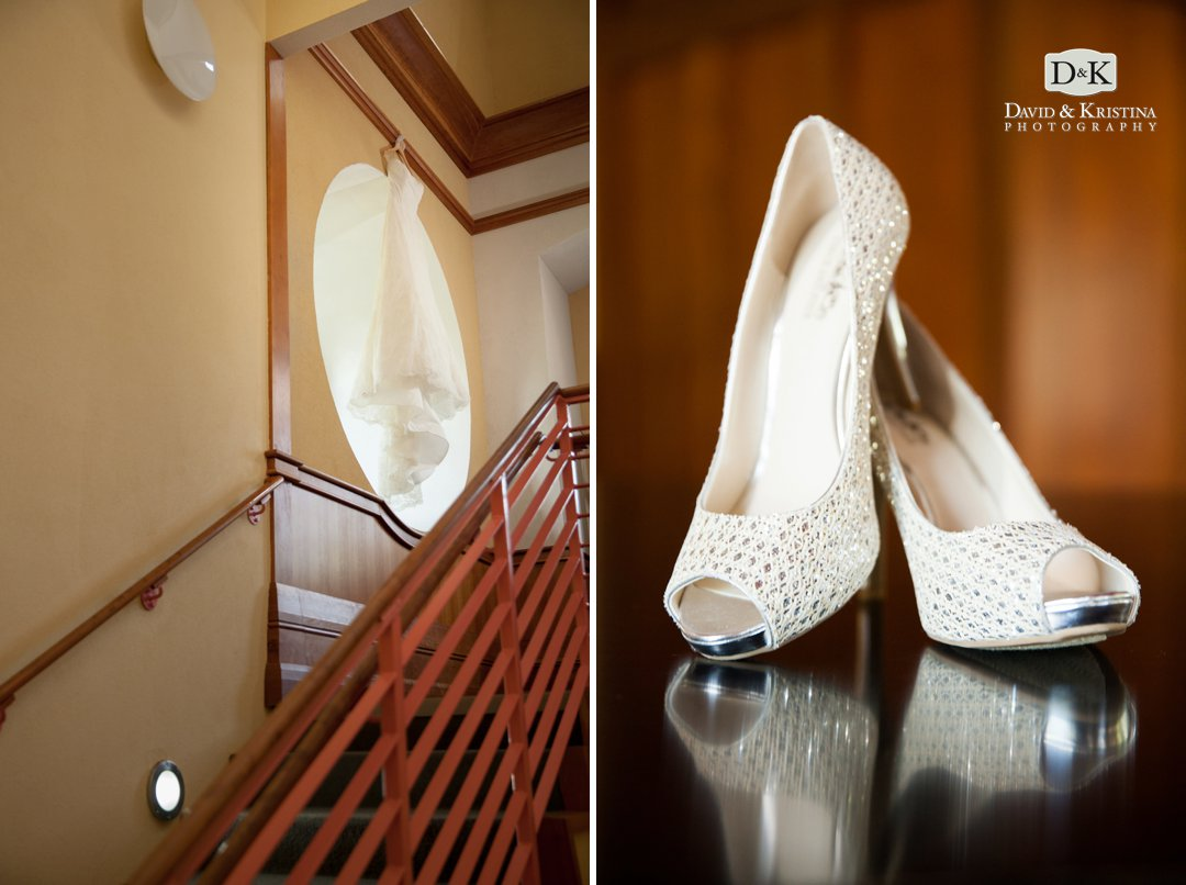 wedding dress hanging in stairwell and bride's shoes