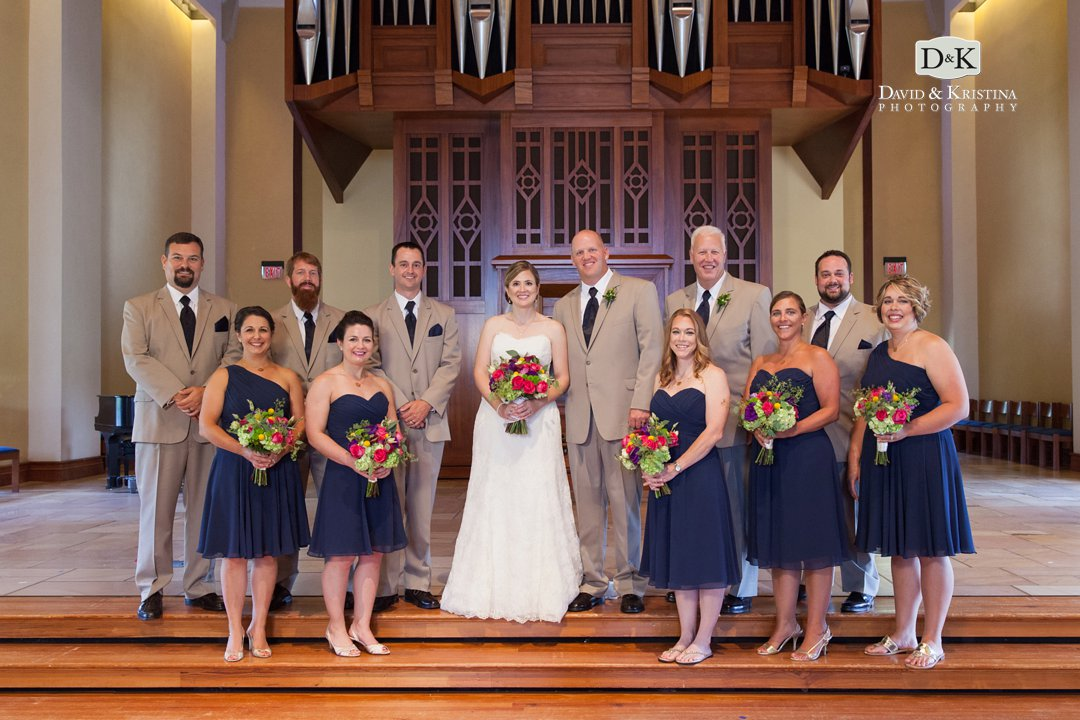 wedding party in front of organ in Daniel Chapel at Furman