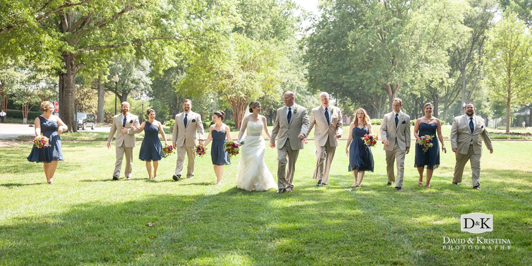 wedding party walking across furman campus
