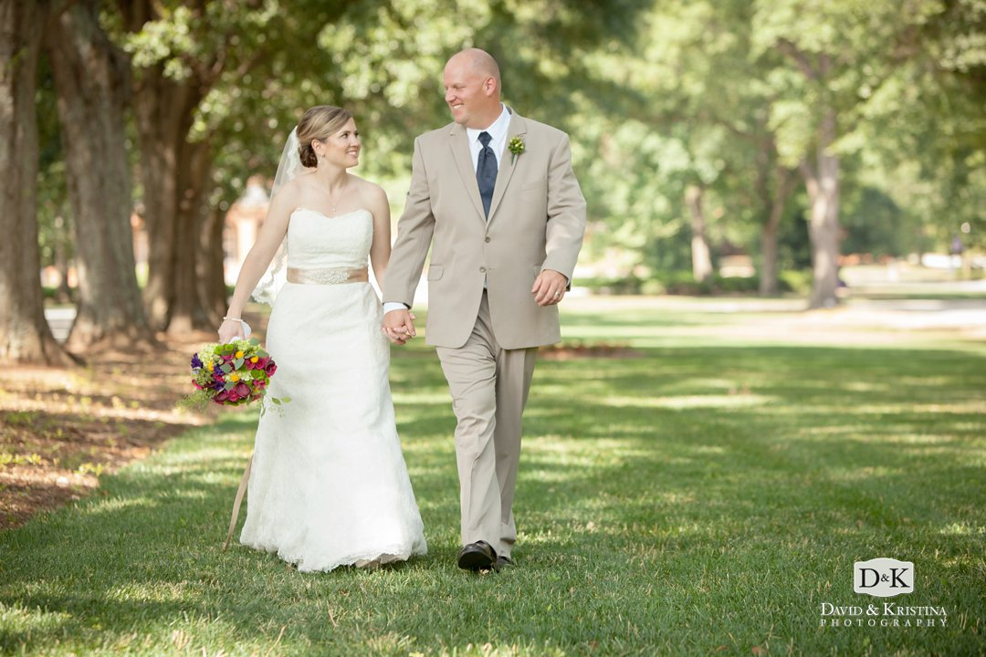 bride and groom walking on Furman campus after wedding