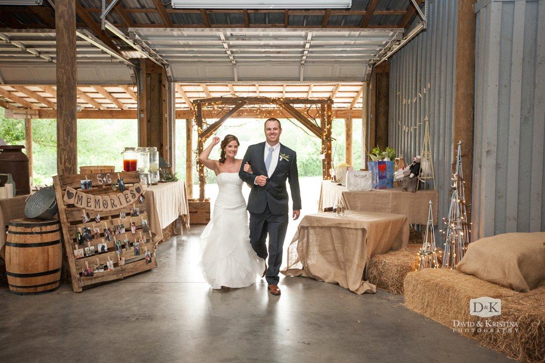 bride and groom enter Greenbrier barn