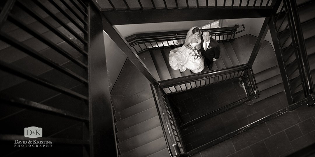 bride and groom on staircase at Wofford Main building
