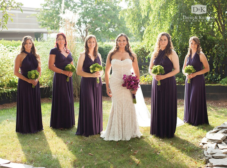 bride with bridesmaids in purple dresses