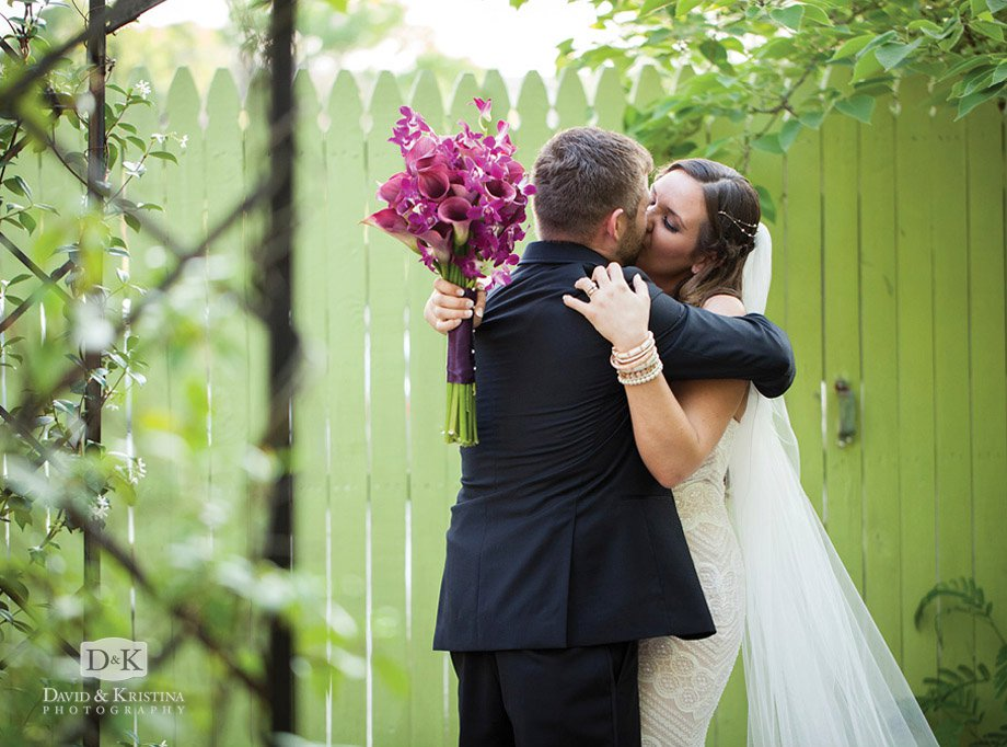 bride and groom candid kiss