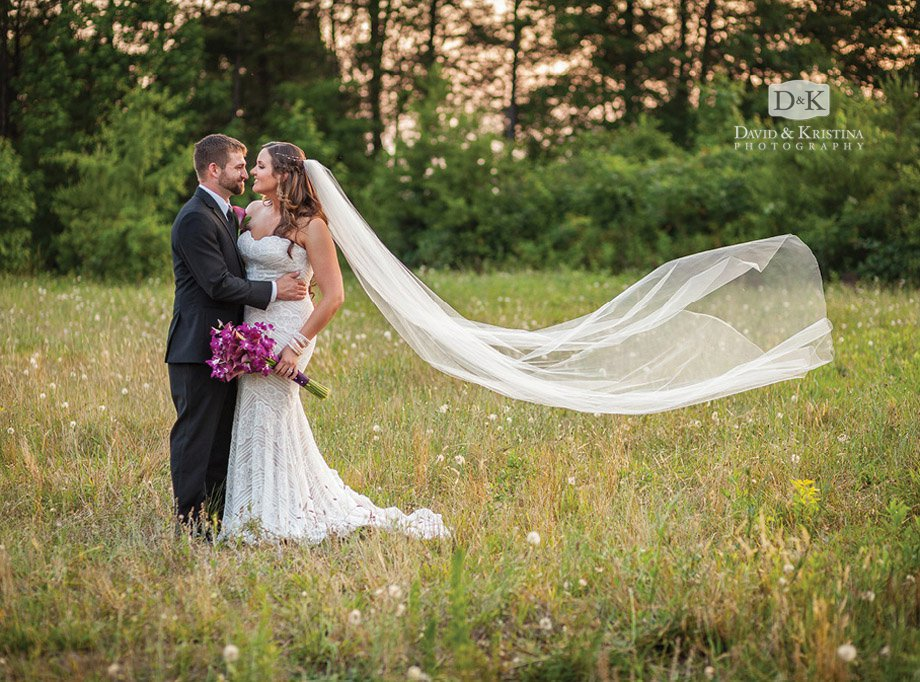bride and groom long veil blowing in wind
